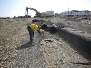 How to install large pipe in a stormwater detention system.