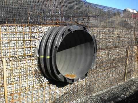Design of pipe penetration through GRS wall.