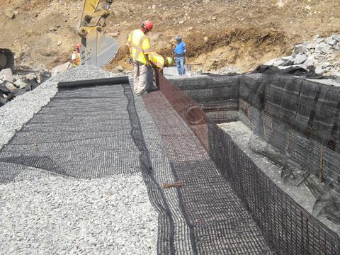 Geogrid wrap wall installation for stormwater application.