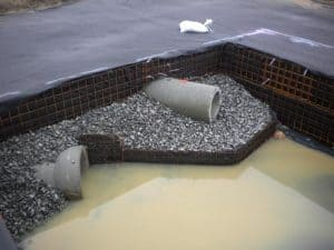 Splash pad installed at inlet pipe for stormwater detention system to prvent scour and erosion.