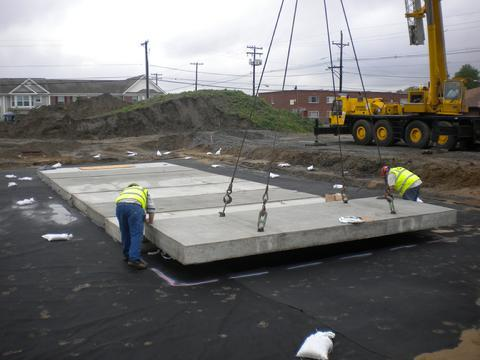 Concrete lid with lifting lugs for stormwater detention vault.