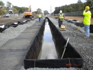 stone compaction limits subsidence of road surface.