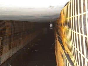 GRS walls exhibit no deflection when loaded with surcharge. HS-20 loads from vehicles represent live lods and soil overburden represents dead loads. AASHTO factor or safety are applied to the loads for the bridge deck design.