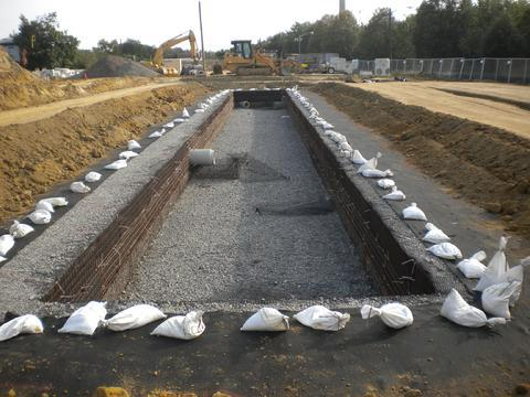 Placement of soil layers above stormwater detention system.