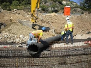 Positioning stormwater inlet pipe.