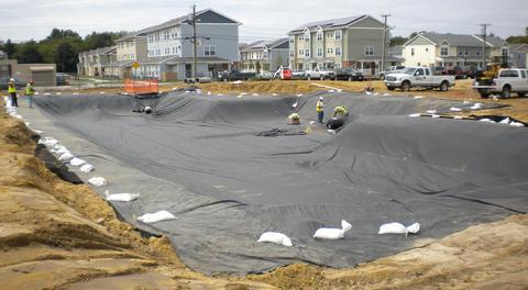 Geomembrane Installation typical for a stormwater system located over karst limestone.