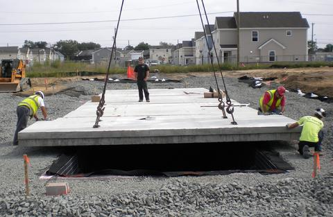bridge panel installaion for roof of infiltration cistern.
