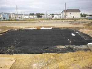 geotextile filter surrounding stormwater infiltration system.