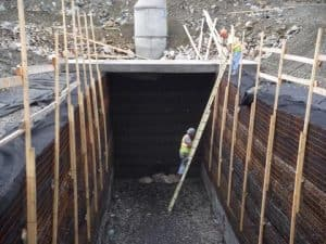 Polyester geogrid placement in stormwater detention system.
